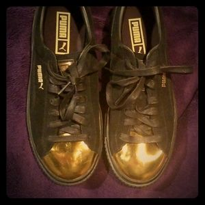 PUMA black suede and gold sneakers